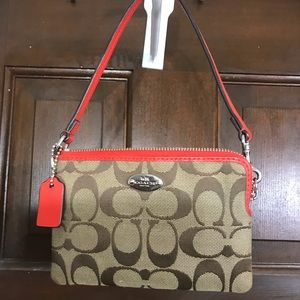 Red and Tan Coach Wristlet